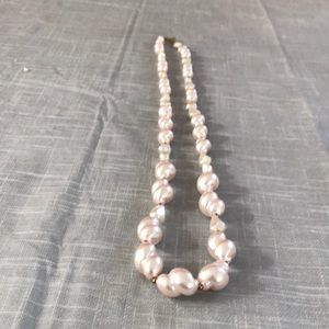 Faux pearls graduated in size